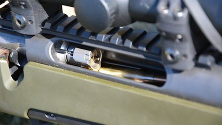 Showing the bolt riding over rounds not fully sprung upward onto the feed lips