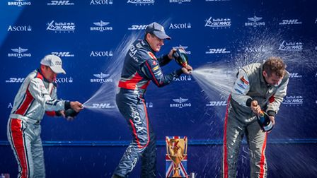 Following motor racing tradition, the air race winners celebrate victory