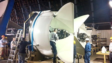 Assembling the four engines, the distinctive array of thrust-rectoring butterfly vanes clearly visib