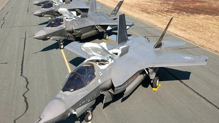 The nearest aircraft are F-35Bs, parked with LiftFan and Auxiliary Air Inlet Doors open