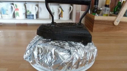 Replace the lid, wrap in foil and weigh down