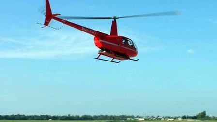 The electric R44's batteries are carried in an underslung palette
