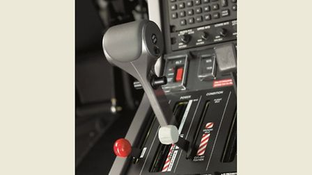 Power lever, flanked by flap selector (red knob) and condition (white knob) levers