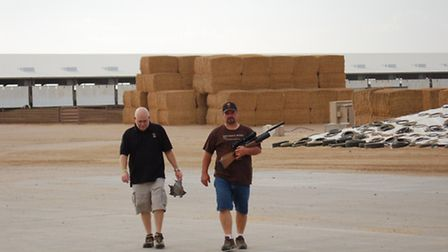 Robert (L) and Kip walking back after picking up a couple birds