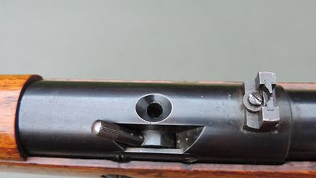 Both cocking and loading levers were used on post-war Model 50s
