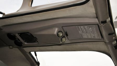 Overhead panel mounts speaker, fresh air vents and airliner-style individual reading lights