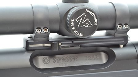 Single release lever for the scope mount has a `safety catch` to prevent accidental detachment. Note