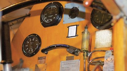 Details include a modern stand-by compass (set in grey panel) supplementing the original mounted in