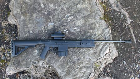 Spring-powered, break-barrel action in a synthetic stock - black, of course,
