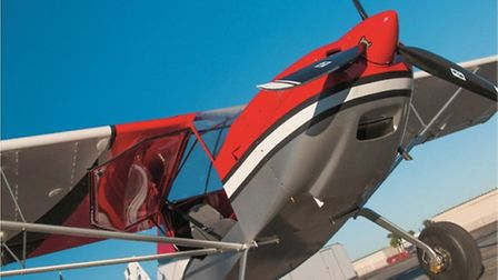 Top-hinged doors make cockpit access easy, can be left open for speeds up to 87 knots