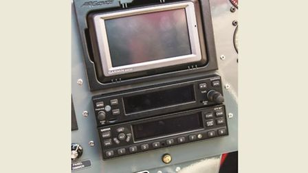 Garmin Aera GPS, transponder and transceiver, stacked neatly in the centre of the panel