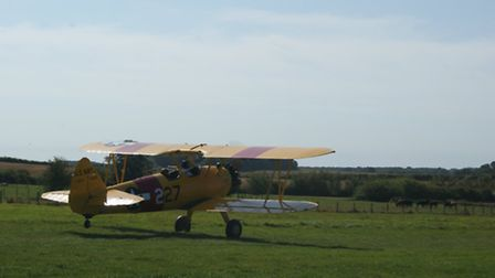 Regular visitor Rob Davies in his Stearman, departing on the downhill runway 25