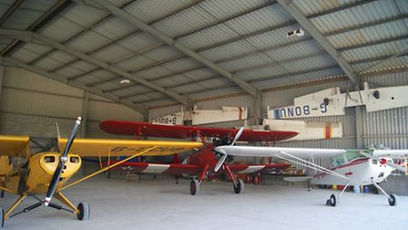 Cub, Cessna and Stearman in one of four hangars at Pent Farm