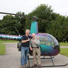 Rusty Waughman is ready for his first helicopter flight, as David Monks takes him on the Pooley's Du