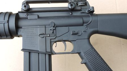 The carrying handle is detachable and contains the aperture rearsight