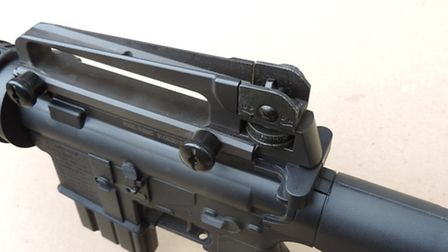 The rear aperture sights are adjustable vertically and laterally