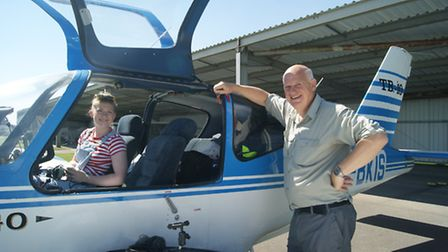 Jeremy Gildersleeves and his daughter Abigail about to fly their TB-10