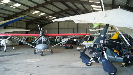 The Somerset Microlights hangar is packed out with rigged and de-rigged (for cheaper hangar rates) m