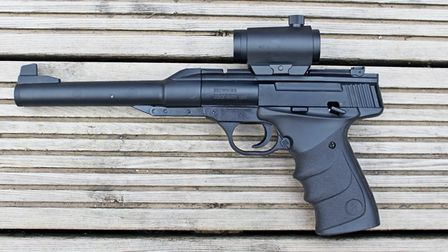 The Umarex Browning Buckmark URX, here fitted with a smalled, red-dot sight