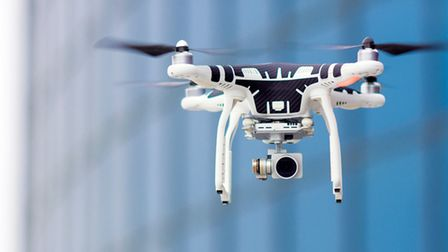 Hovering drone that takes pictures of city sights, agnomark, Thinkstock