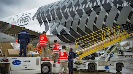 Loading of relief goods on an Airbus A350 XWB test aircraft at Paris Charles de Gaulle PHOTO: H Gous