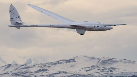 The Airbus Perlan Mission II pressurized glider soars above the peaks of the Andes near El Calafate