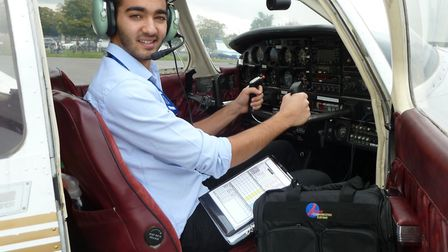 Biggin Hill Airport Flying Scholar Ben Akhtar tries out his new kit in the cockpit of an EFG Flying