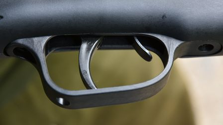 The tab in front of the trigger blade is the manual safety.