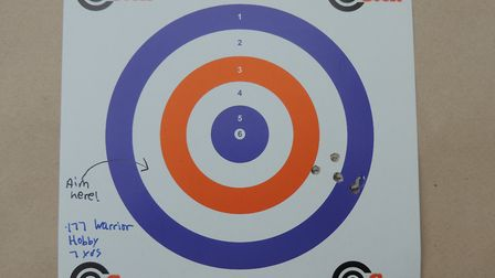 If your pistol has fixed sights and shoots to one side, you simply aim in the opposite direction.