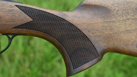The grip (showing chequering)