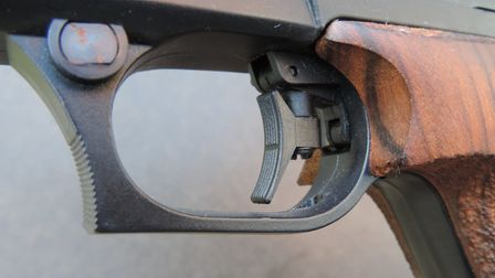 A match pistol's trigger can be adjusted every which way and down to a very light release weight.