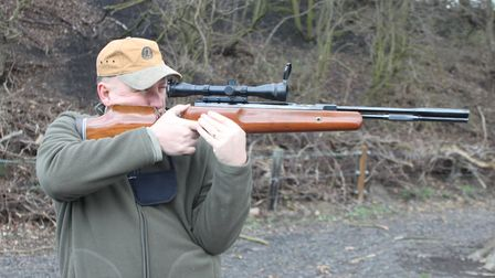 Standing shooting my HW77 in a target style with the elbow on the hip bone and the supporting hand w