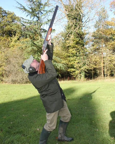 so from the previous starting position you end up like this, head off the stock, back arched, weight