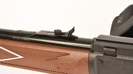 The rear sight is adjustable for windage and elevation.