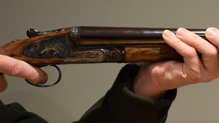 The correct front hand grip, three fingers gripping the side of the barrel walls, thumb along the ot
