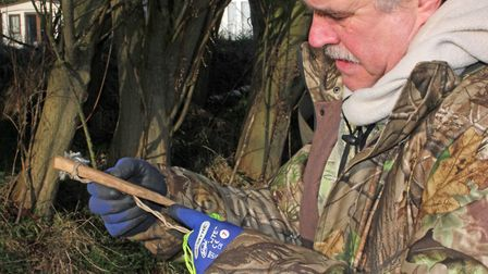 Mick uses long, wooden pegs, which he makes himself. They work better in soft/sandy ground, and they