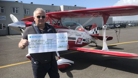 Hosie with an oversized cheque