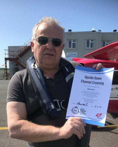Will Hosie holds his certificate of completion