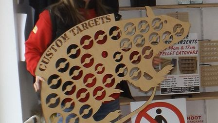 Nikki Cox displays a 'less challenging' target for the novice shooter.