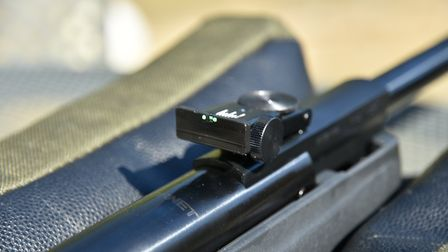 The rear sight is fully adjustable for winage and elevation.