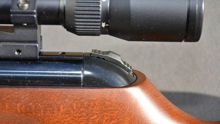 A shotgun-style safety sits conveniently at the rear