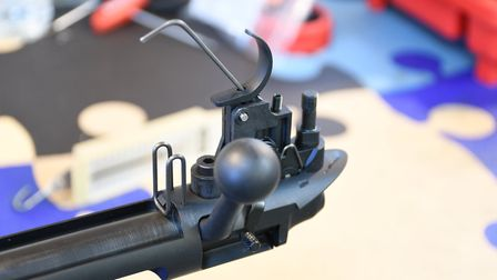 7. The trigger shows full weight adjustment for sporting shooters within its Polymer frame. Performa