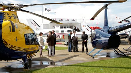 Helicopters and fixed-wing aircraft on static display