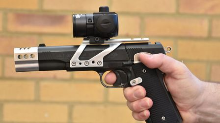Ensure your middle finger is hard against the trigger guard