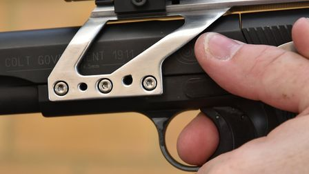 Only the pad of the trigger finger should touch the blade