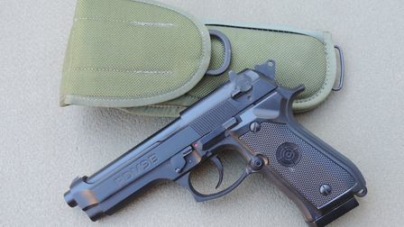 The PDM9B seen here with an original U.S. army holster intended for the Beretta.