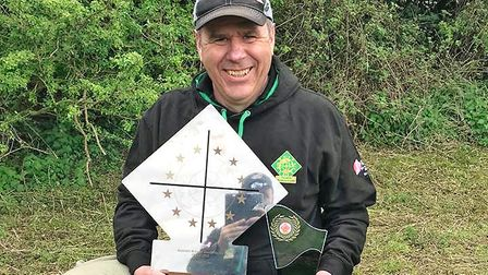 Chris Pantling with his hard-earned trophies. A top shooter who has offered me much free advice over