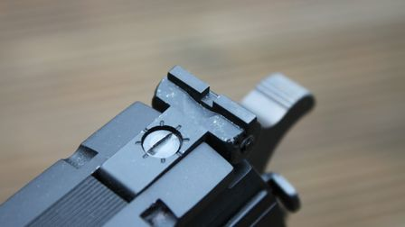 The rear sight is simple but adjustable.