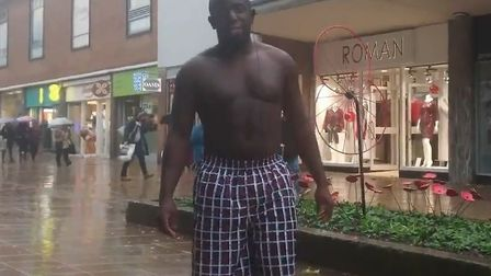 Femi Oluwole strips off to encourage people to register to vote. Photograph: Twitter.
