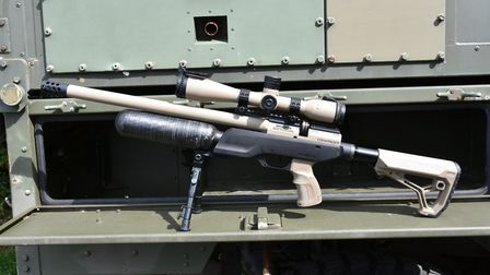 A military looking rifle on a military truck